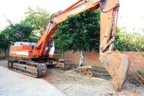 Large excavation tractor used for trenching yards for landscaping
